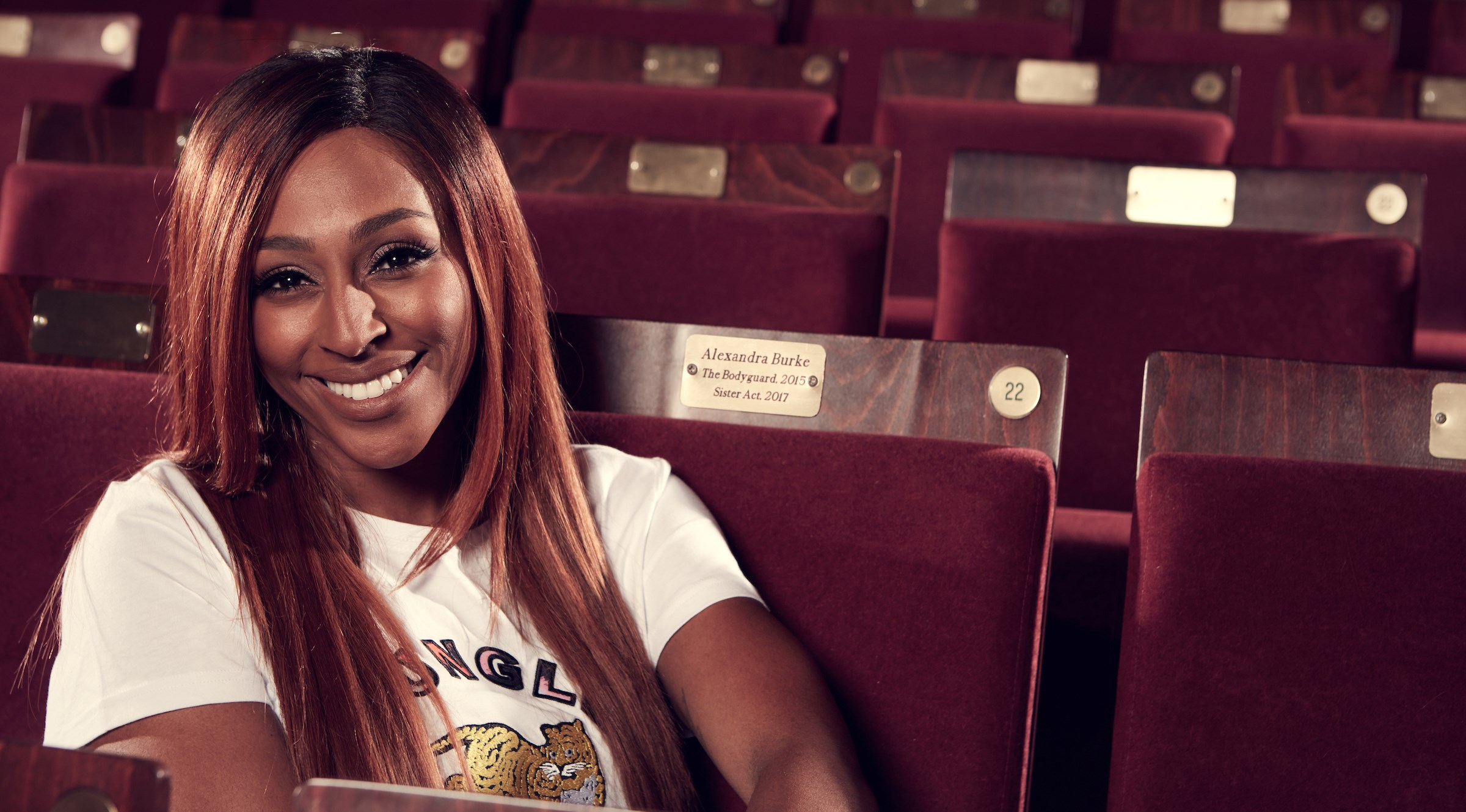 Alexandra Burke presented with auditorium seat at the Grand